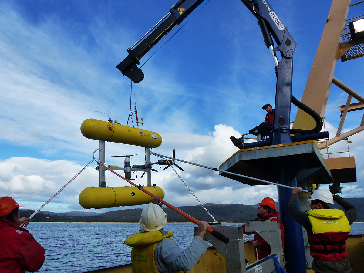 An autonomous underwater vehicle being deployed from a  vessel