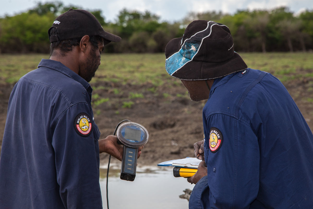 Indigenous rangers testing water quality at Daly River, NT.