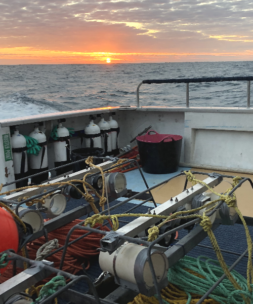 Underwater video equipment on the deck of a vessel in the sunset