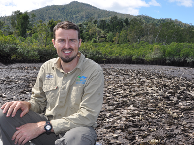 Dr Ian McLeod From James Cook University sits near a leaf oyster reef in Hinchinbrook Channel.