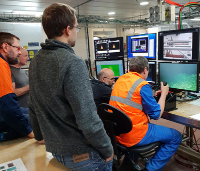 scientists watch the live feed of the seafloor