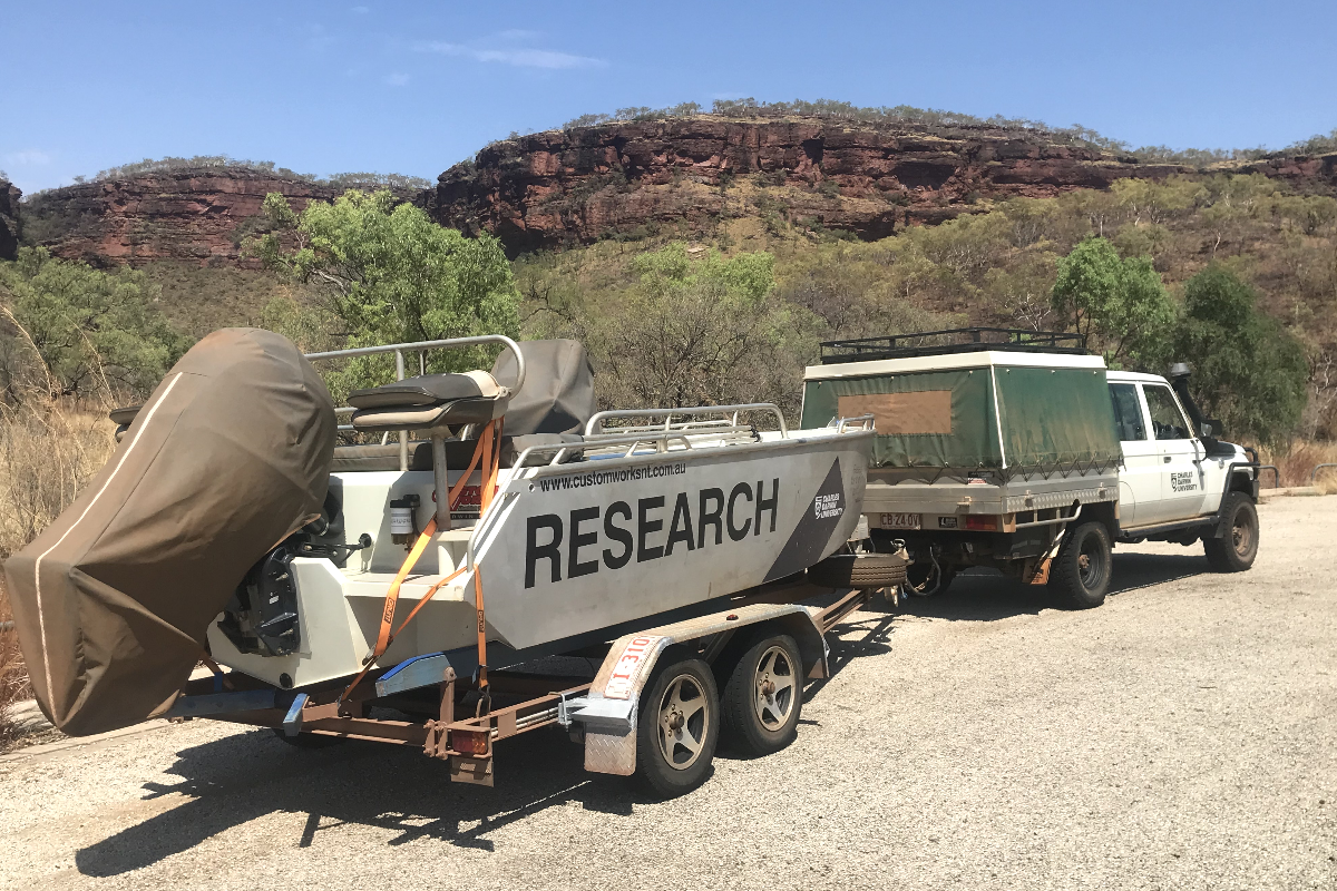 A research vessel on a trailer behind a ute