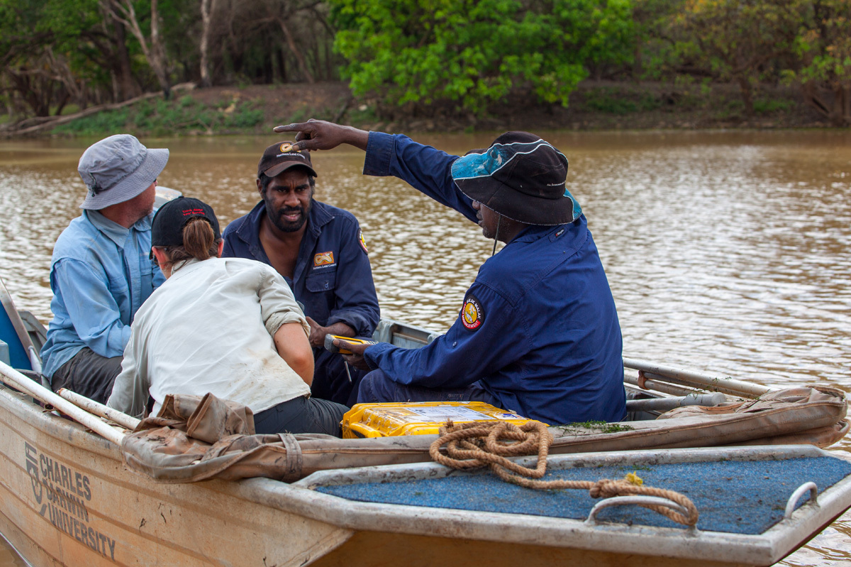 Scientists and Indigenous rangers in a boat on the Daly River, NT