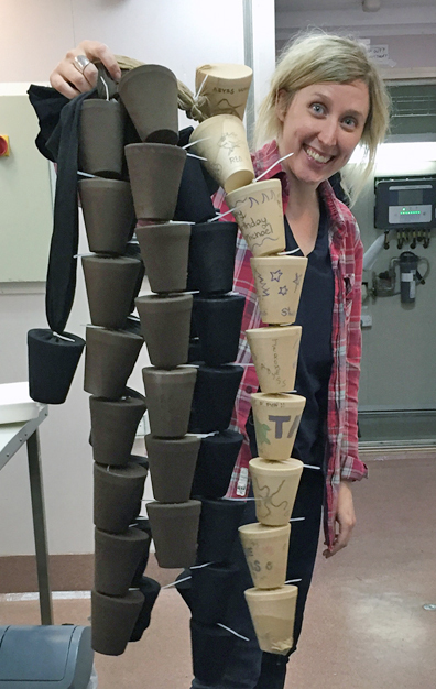 Phoebe Lewis with strings of cups