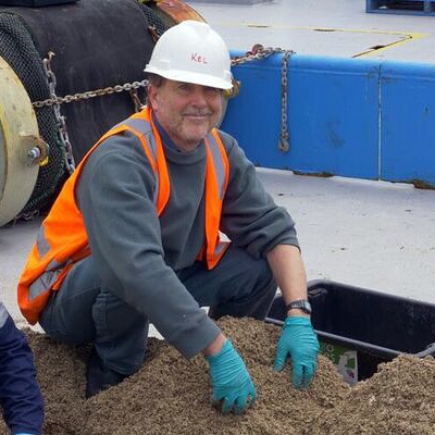 Simon Grove on deck with a pile of shell grit