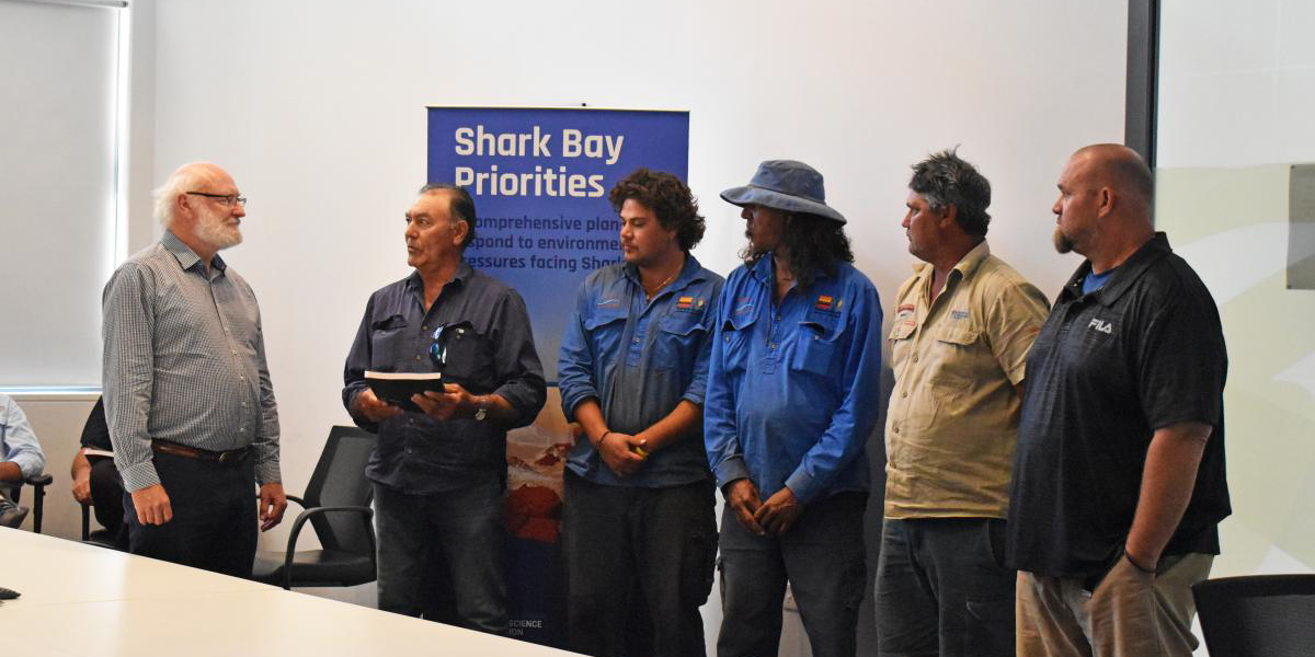A group of people from UWA and Malgana Rangers at a presentation of Shark Bay research
