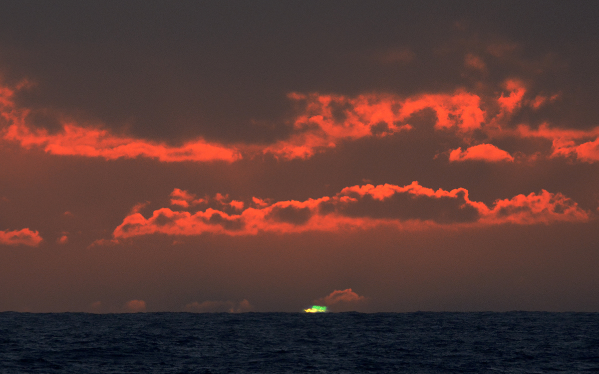 Green flash at sunset over water