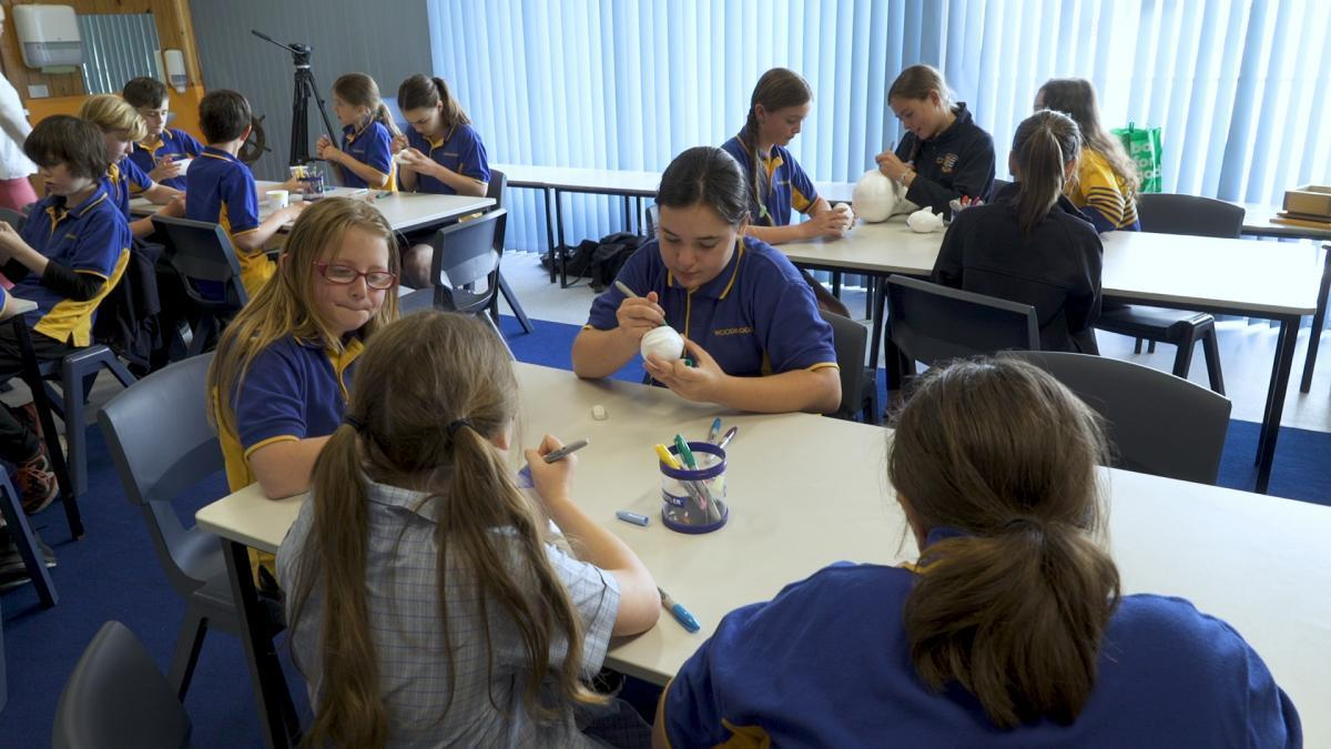 Woodbridge primary students paint styrofoam cups