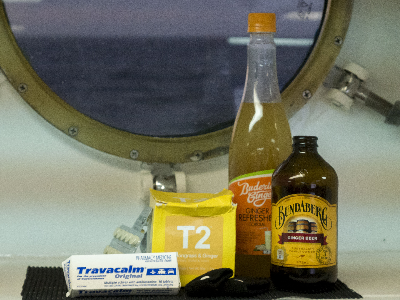 A collection of ginger products in front of a porthole