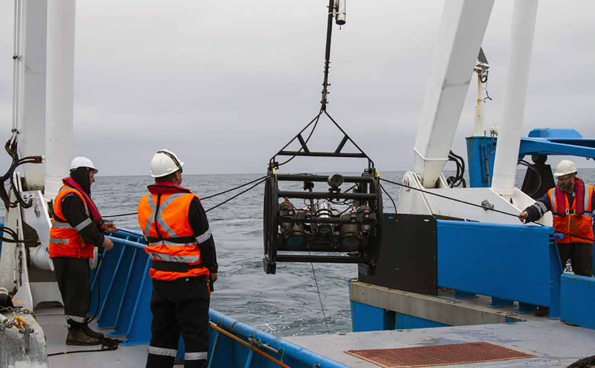 Crew members deploy the deep-tow camera