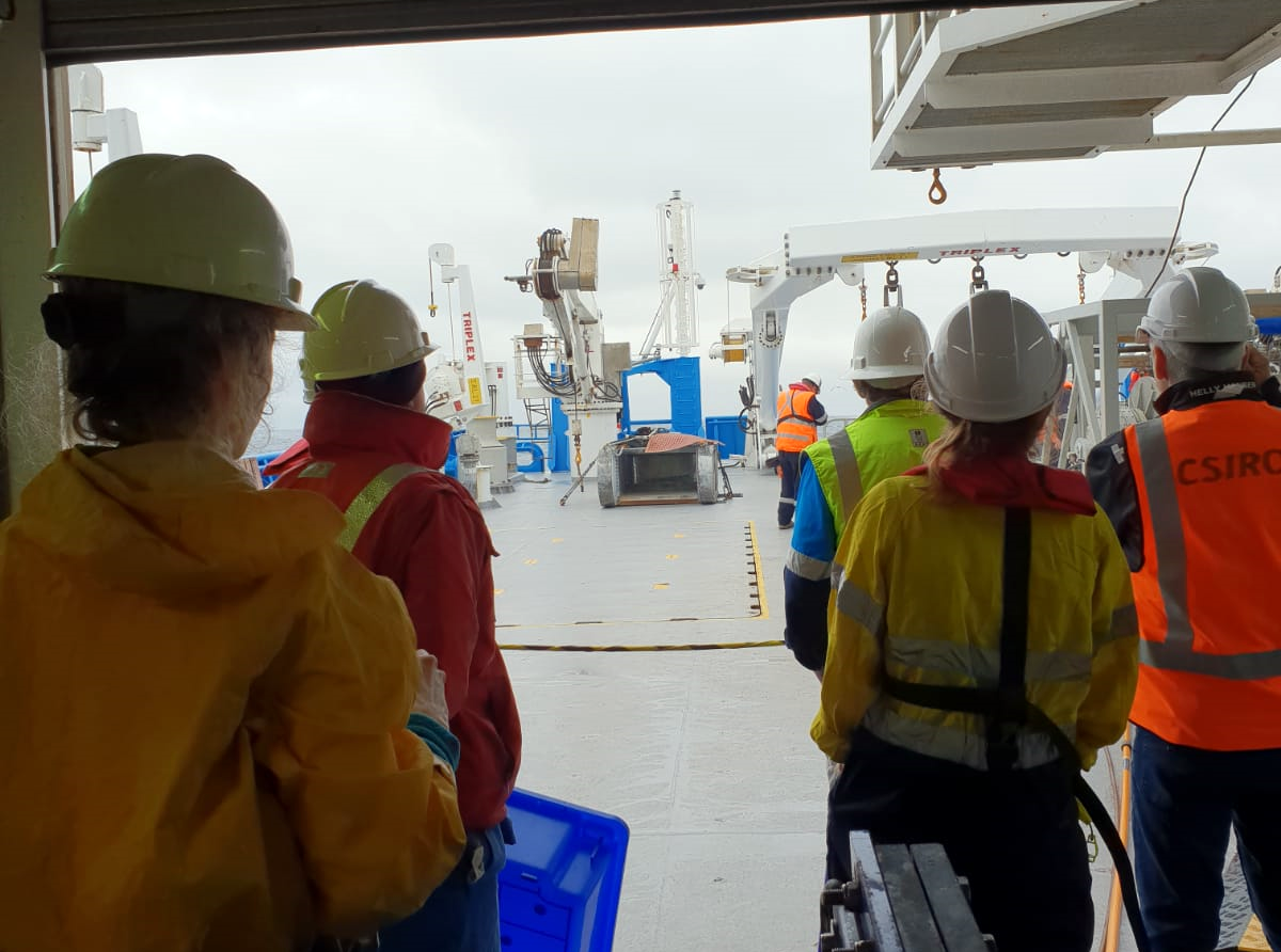 Scientists wait on deck for the beam trawl