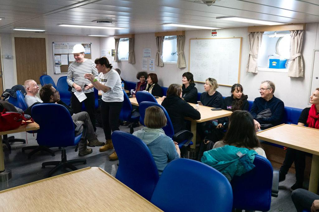 The science team meeting in the ship's dining room.