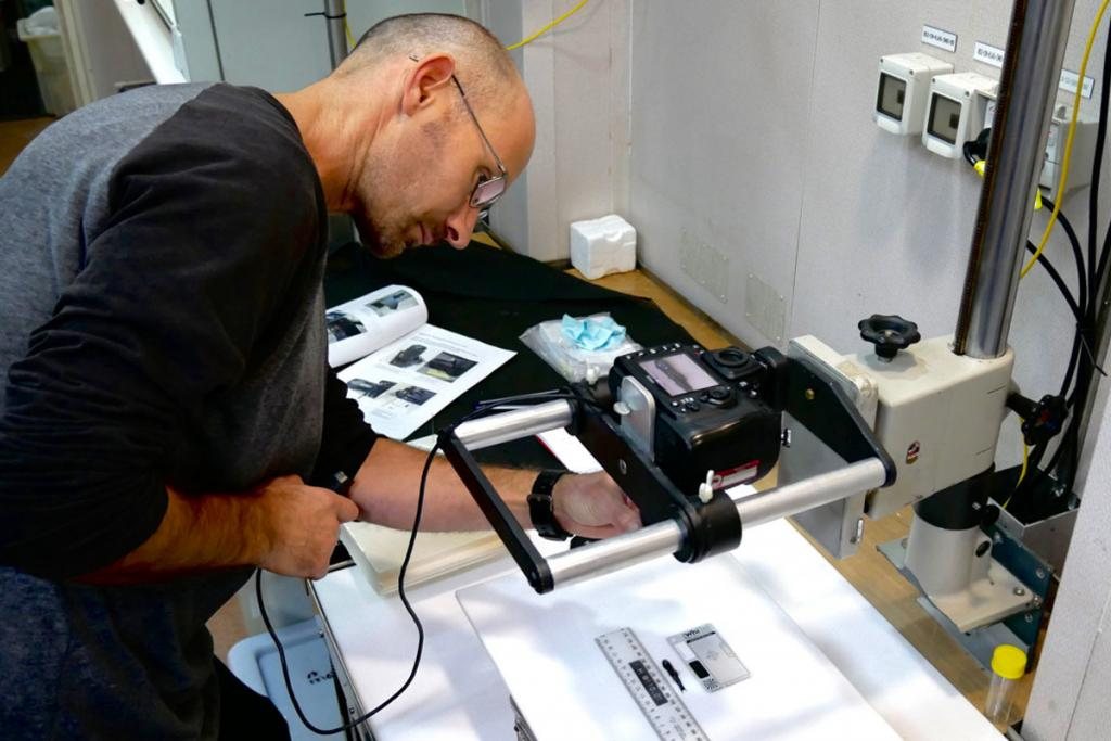 A scientist photographs one of the first fish sampled on the voyage.